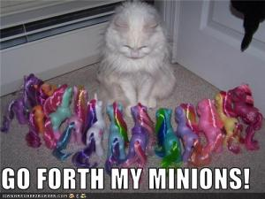 funny-pictures-cat-has-toy-pony-minions